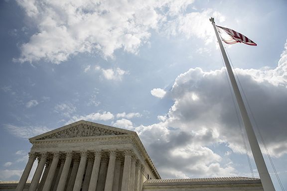 The U.S. flag flies in front of the Supreme Court in Washington,  in this  May 18, 2015 file photo.  REUTERS/Joshua Roberts/Files