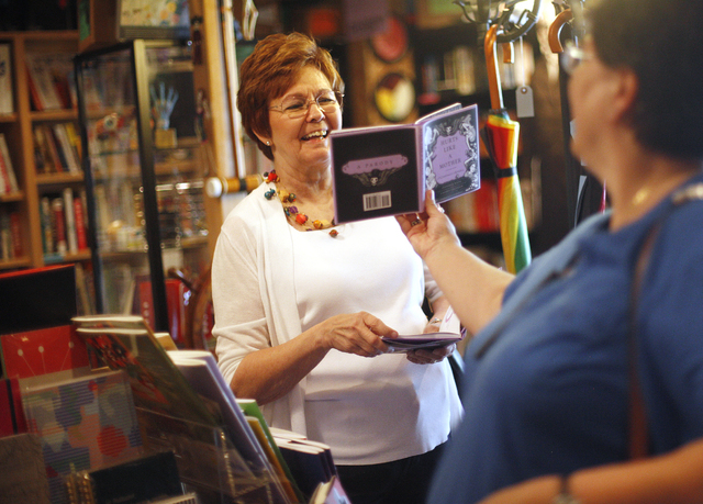 Kelly Lavigne, right, shows her mom Randy Lavigne a book at the Writer's Block in downtown Las Vegas on Tuesday, June 7, 2016. Rachel Aston/Las Vegas Review-Journal Follow @rookie__rae