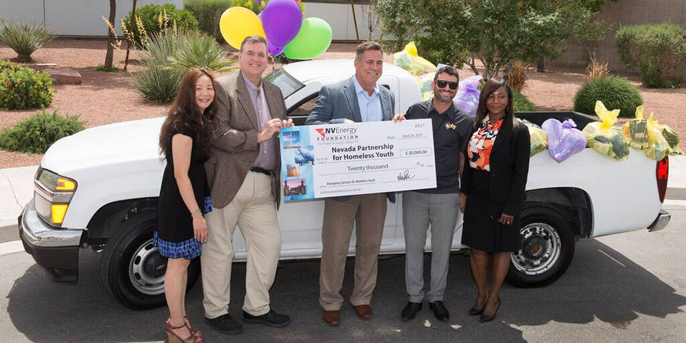 NV Energy officials present a $20,000 donation and a gently-used truck to Nevada Partnership for Homeless Youth to help youth in crisis. (Courtesy)