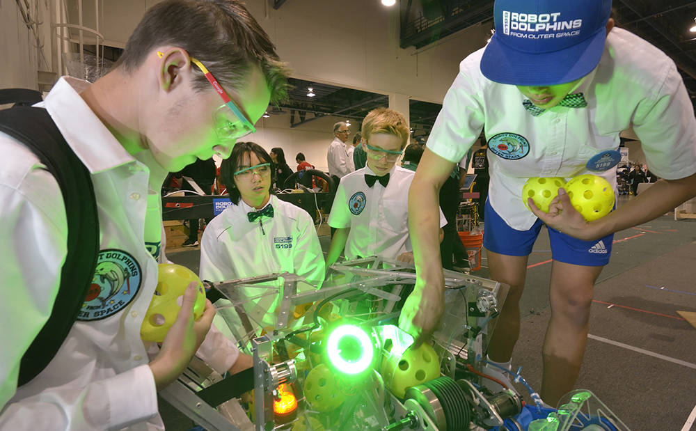 Team members from Carl Hayden High School in Phoenix get their robot ready in the staging area. (Bill Hughes/Las Vegas Business Press)