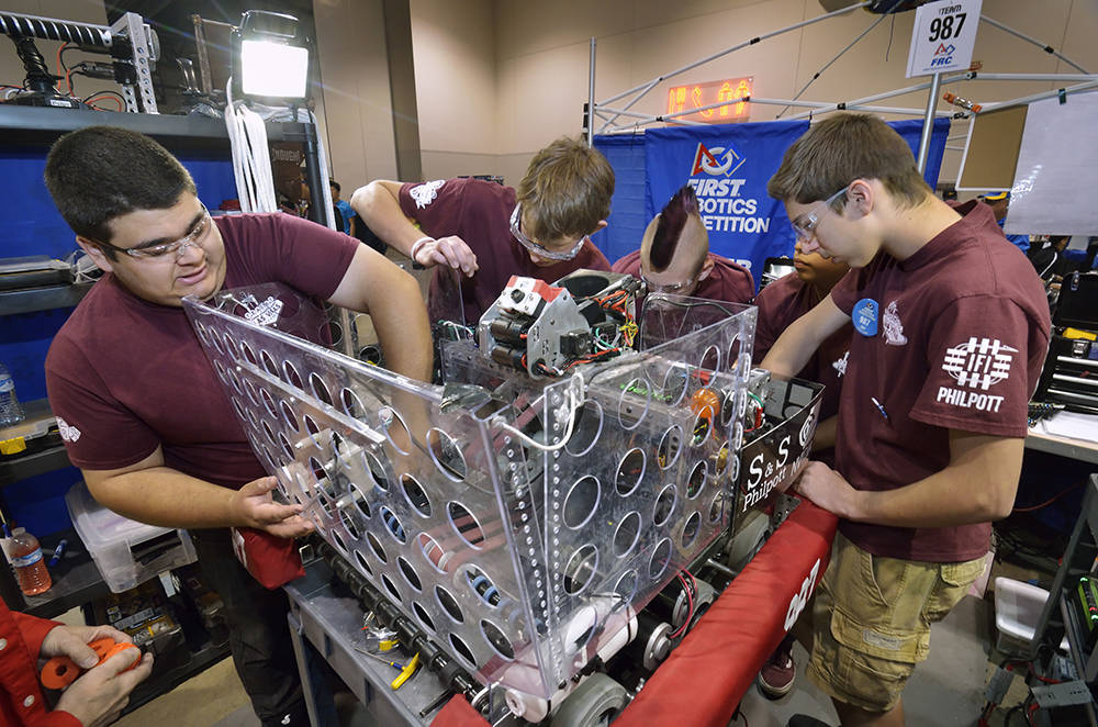 Cimarron-Memorial High School students work on their robot during the FIRST Robotics regional competition. (Bill Hughes/Las Vegas Business Press)