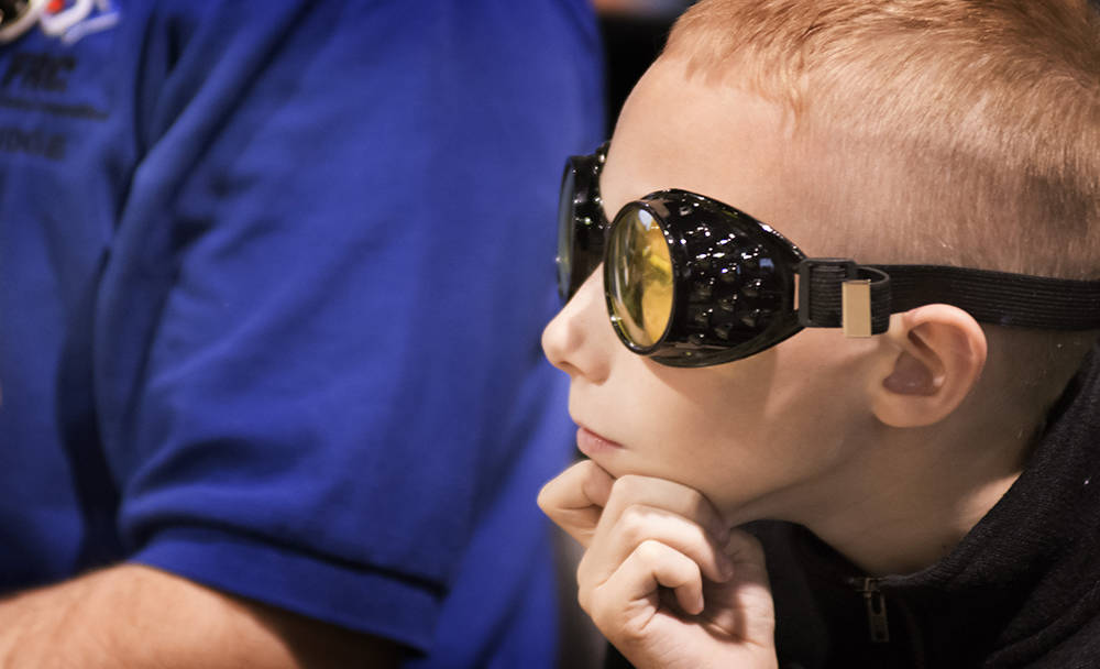 Nathan Rogers watches from the stands. (Bill Hughes/Las Vegas Business Press)