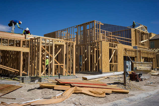 Construction workers build a town house on Irene Porter Street in North Las Vegas. James Tensuan Las Vegas Review-Journal