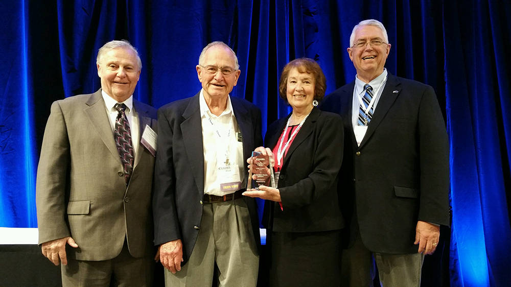 NRHA Leadership accepts the National Excellence Award. Left to right: Roger Mancebo, NRHA vice chairman; Willis Swan, NRHA commissioner; Rose Cook, NRHA chairwoman; Bill Brewer, NRHA deputy direct ...
