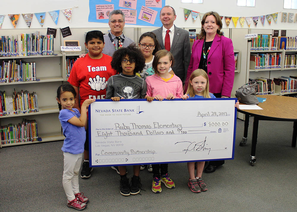 Nevada State Bank presented a check for $8,000 to Ruby Thomas Elementary School April 28, in celebration of Teach Children to Save and to support the school's education efforts. L to R: Dennis K ...