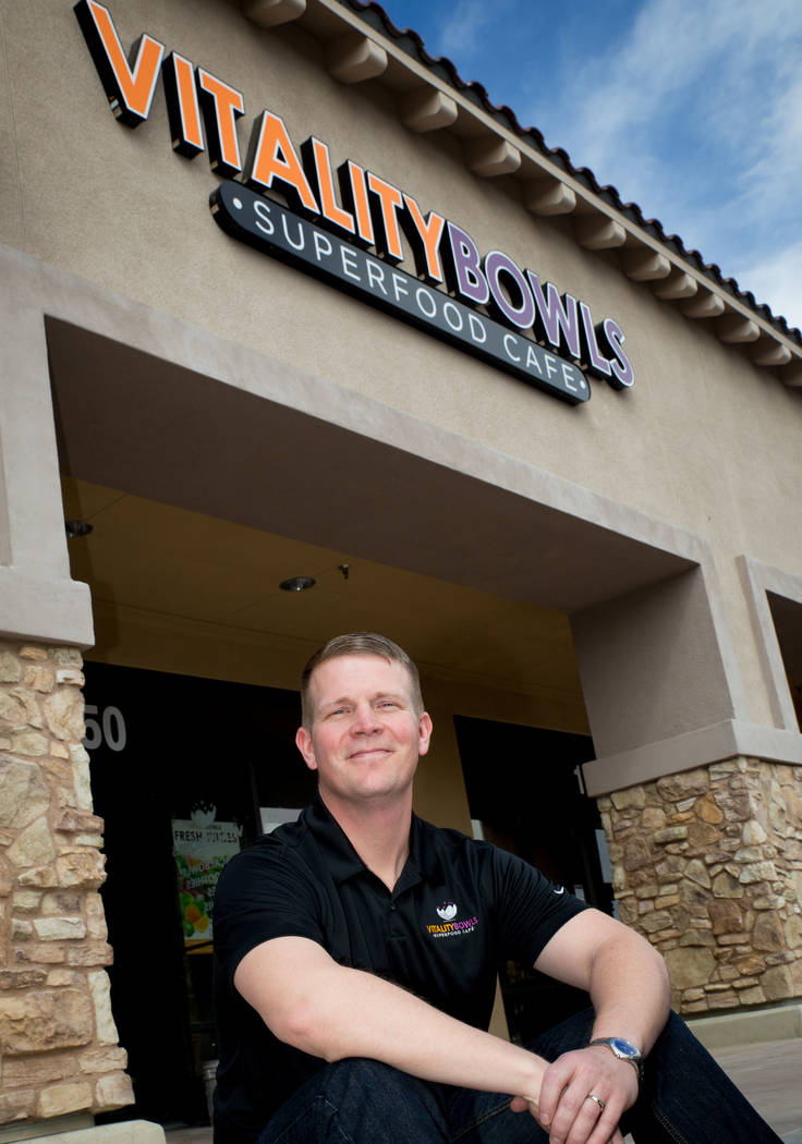 Stephen Belcher, co-owner of Vitality Bowls, a new healthy food option in Las Vegas, sits in front of his store that opened in mid-April. (Tonya Harvey Las Vegas Business Press)