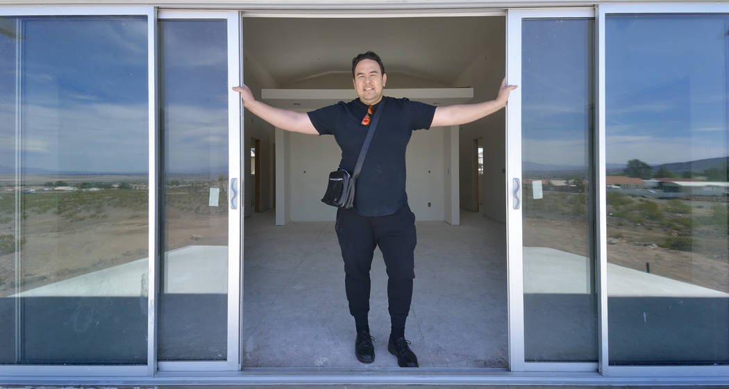 Bill Hughes/Las Vegas Business Press Designer Aeron Tozier is shown in a custom home he built at 328 N. Lisbon St. in Henderson.