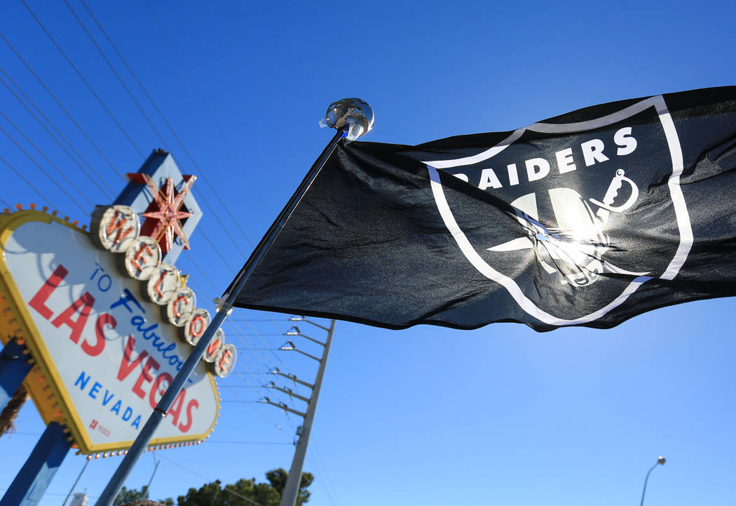 A Raiders flag blows in the wind during a draft day party for the Raiders. (Brett Le Blanc Las Vegas Business Press)