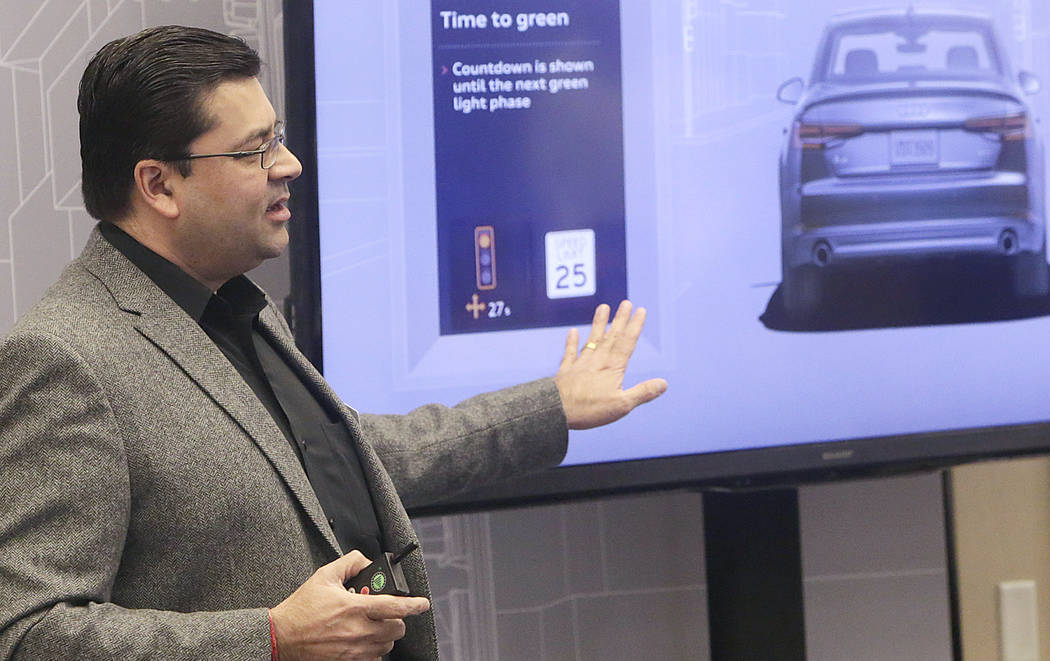 Anupam Malhotra, director of connected vehicles for Audi America, talks about Audi connect during a demonstration on a countdown timer for red lights, Dec.6 at RTC Traffic Management Center. (Bizu ...