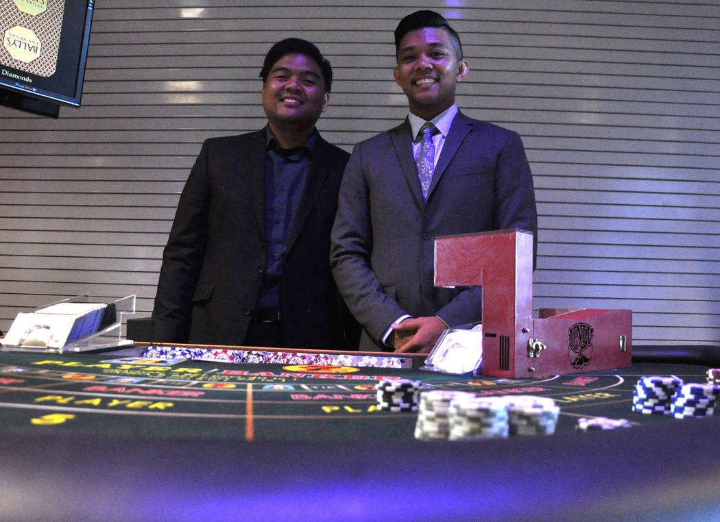 UNLV Department of Electrical and Computer Engineering students Kyle Ebuen, left, Manuel Degracia and Russ Prado (not pictured) designed a the Card Shoe Protection System, intended to prevent the  ...