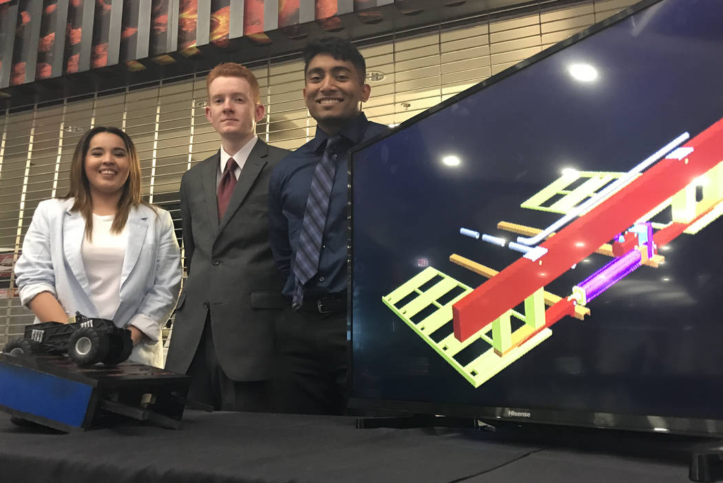 Kay Van, left, David Morris, Preetish Raj and Pono Perez (not pictured) of Notorious C.I.V. designed a retractable rumble strip to warn drivers of pedestrians in crosswalks. Photo by Buford Davis  ...