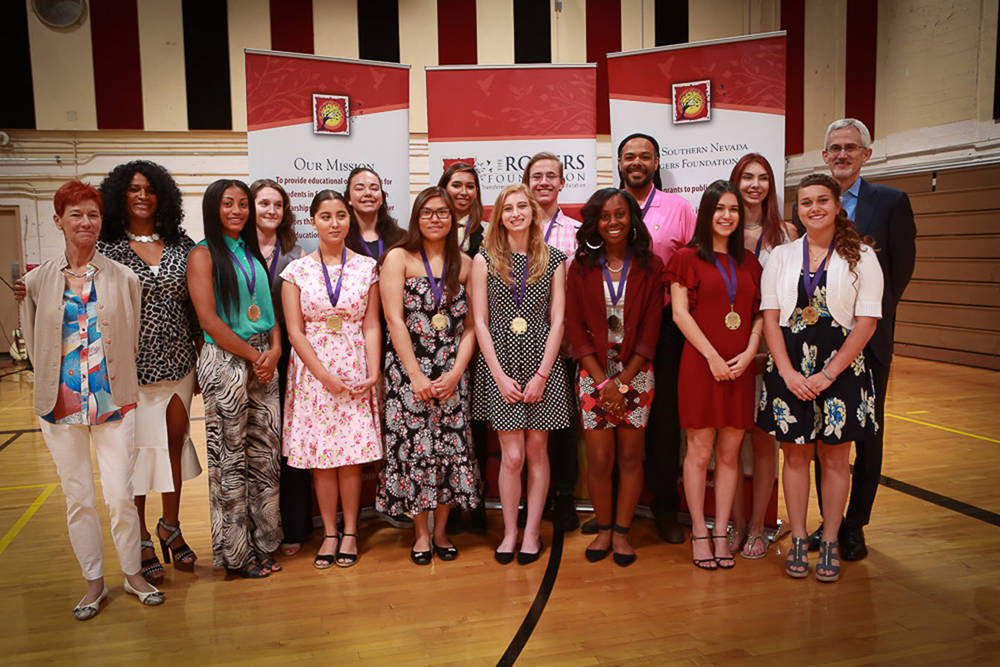 Chairman of The Board Beverly Rogers, Grant and Scholarship Director Michelle Sanders, some of the 14 Kentucky Wesleyan College full-ride scholarship winners, and President Rory Reid. (Courtesy)