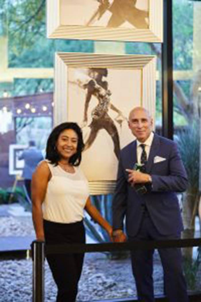 Dr. Eva Littman and artist Alan Hunter at ASCAYA's Ink & Alcohol art installation. (Courtesy)