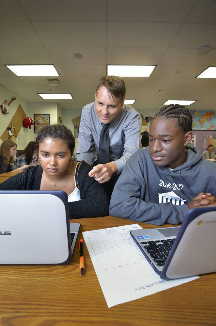 Principal Jonathan Synold, center, talks with Akyra Franklin, left, and Kayhontia-Tyzon (cq) Hall during a class at Advanced Technologies Academy at 2501 Vegas Drive in Las Vegas on Tuesday, April ...