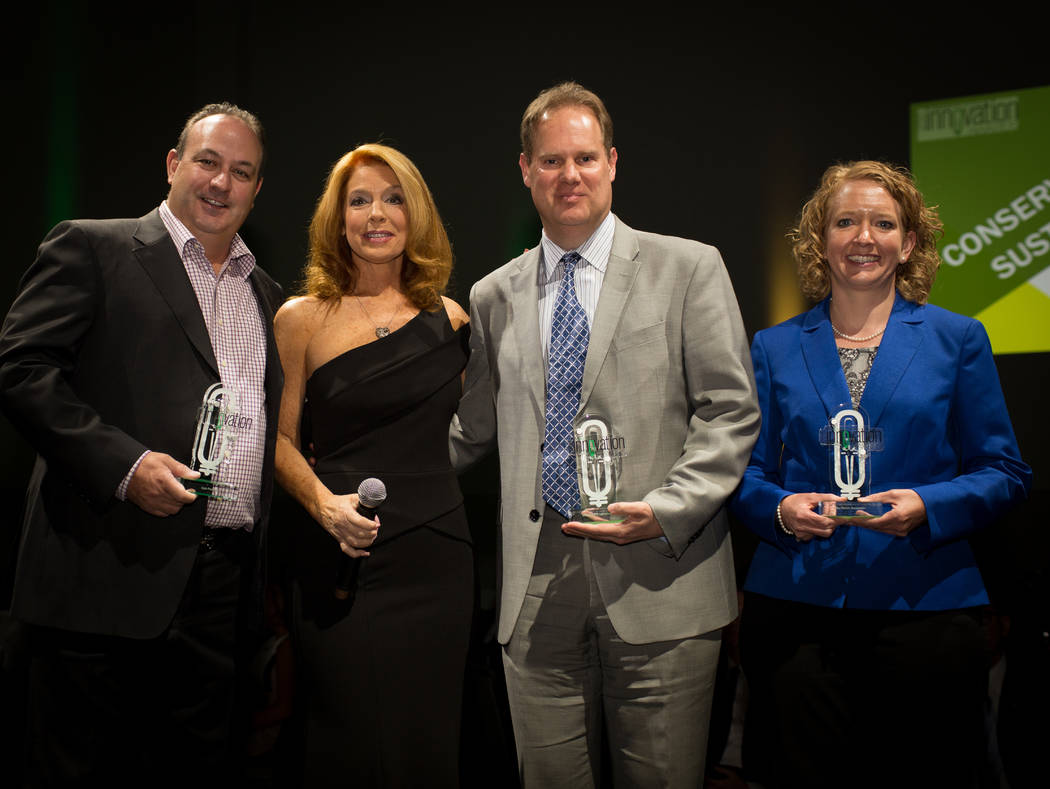 Conservation & Sustainability winners, left to right, Eagle Promotions owner Mario Stadlander, MC Kelly Clinton Holmes, MGM Resorts International Executive Director of Finance and Analysis Hen ...