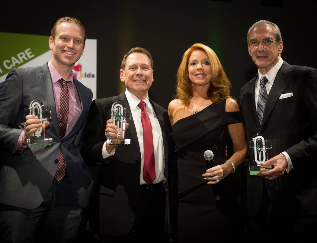 Health care winners, left to right: Southwest Medical Associates Chief Operations Manager Travis Koput, Foundation for Positively Kids CEO Fred Schultz, MC Kelly Clinton Holmes, Cleveland Clinic L ...