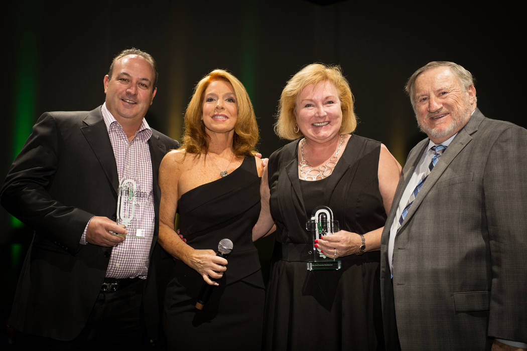 Manufacturing winners, left to right: Eagle Promotions owner Mario Stadlander, Nine Elms founder MC Kelly Clinton Holmes and CEO Liese Peterson and Chairman Don Peterson.