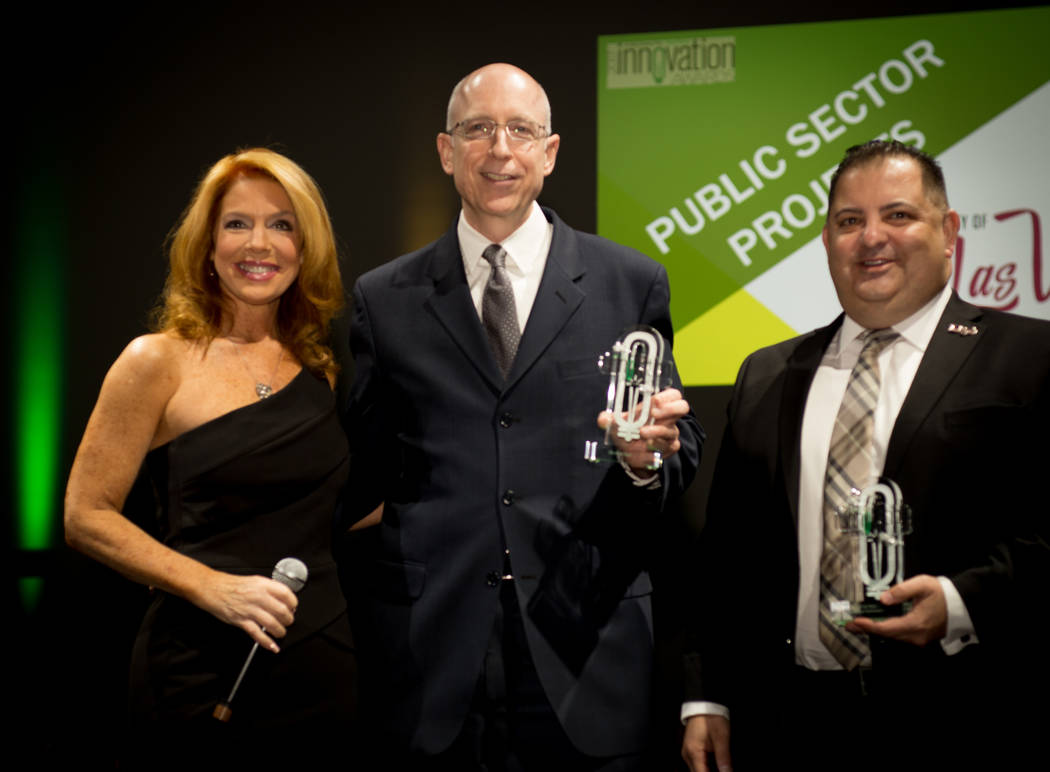 Public sector winners, left to right: MC Kelly Clinton Holmes, City of Las Vegas CFO Gary Armeling and Director of Information Technologies Michael Sherwood.