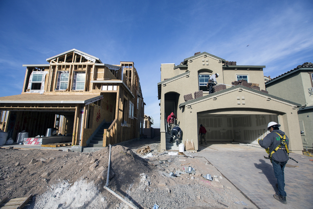 Men work on a single family homes at Cadence. (Jeff Scheid/Las Vegas Business Press)