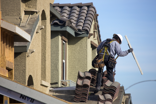 A man works on a single-family homes at Cadence, a 2,300-acre master planned community, in Henderson on Dec. 13, 2016. (Jeff Scheid/Las Vegas Business Press)