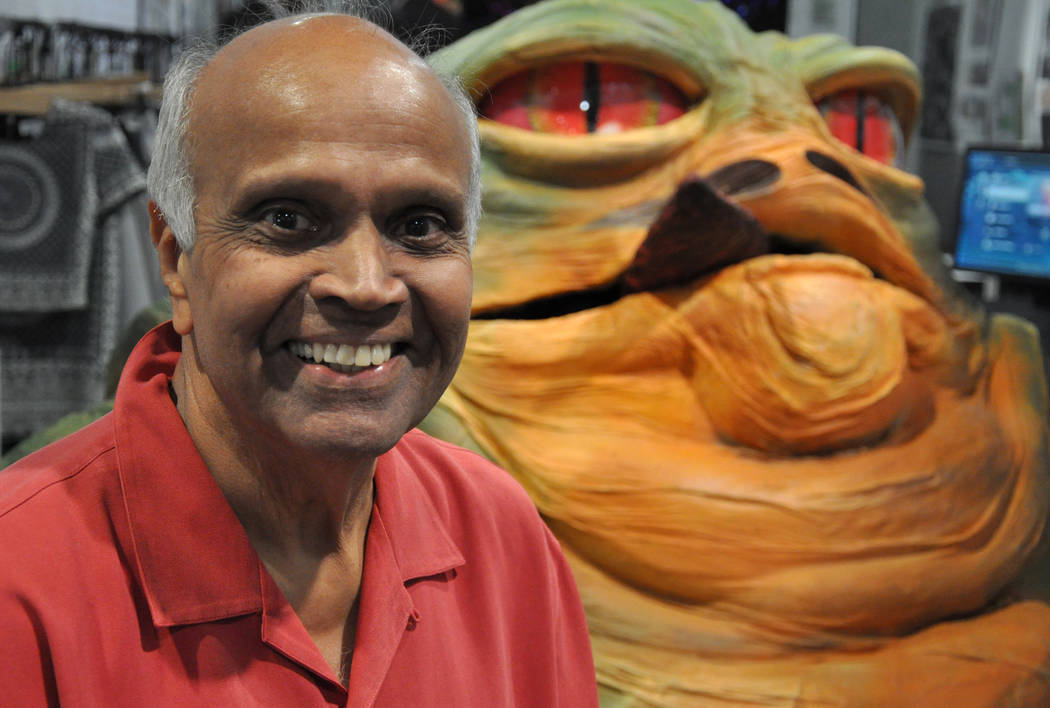 Joshi Rohit of Joshi and Associates sits on a prop depicting Jabba the Hutt - a crime boss in the Star Wars anthology -  at RECon 2017 in the Las Vegas Convention Center and Westgate Hotel, May 21 ...
