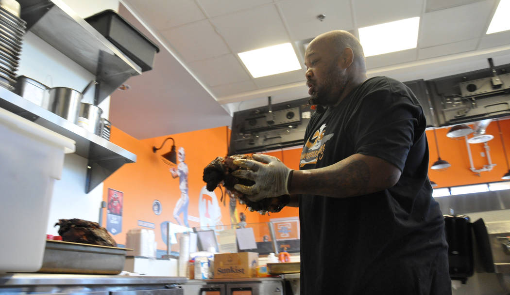 Michael Harris begins preparations for Tennesseasonings' pulled pork each morning about 2 a.m. Photo by Buford Davis / Las Vegas Business Press
