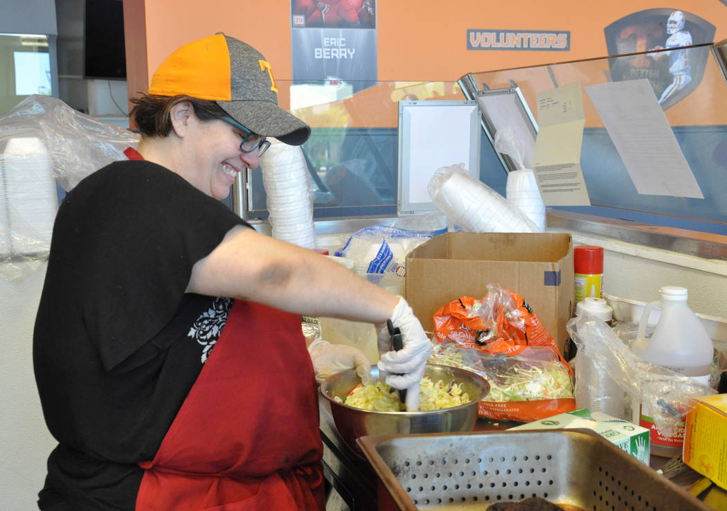 Laura Harris, co-owner of Tennesseasonings, prepares cole slaw for the lunch service, May 23. Photo by Buford Davis / Las Vegas Business Press