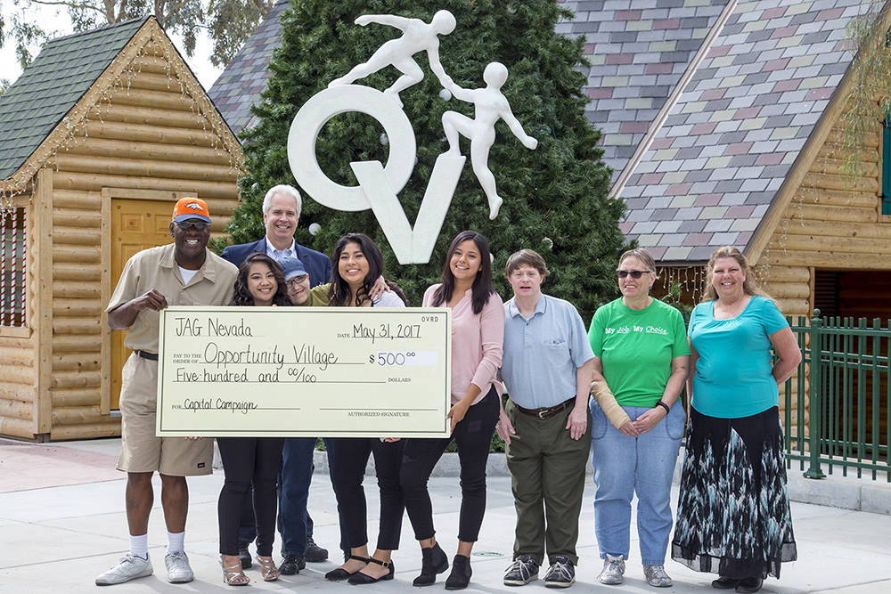 Students from Las Vegas High School's Jobs for Nevada's Graduates program and their specialist visited Opportunity Village's Oakey campus May 31 to present a $500 check to the organization.  ...