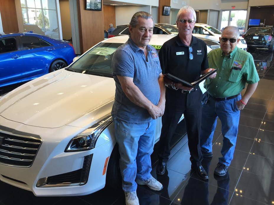 Findlay Cadillac marketing director L.J. Harness, center, is flanked by Veterans Transition Resource Center COO Jim Lytner, left, and VTRC media services director R.J. Dough as the three plan for  ...