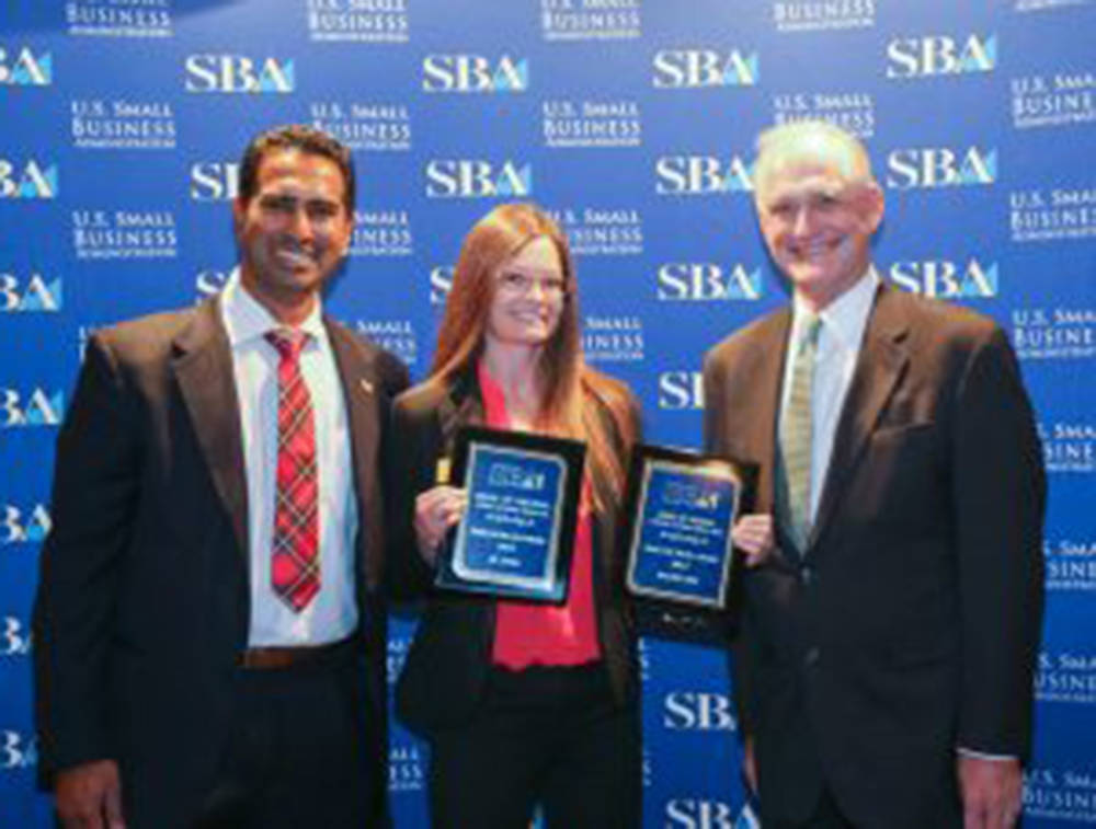 Bank of Nevada was named the number one Small Business Administration 504 Lender in Nevada for 2017. (L to R): Ben Raju, acting district director of the Nevada SBA office; Aimee Burford, VP and se ...
