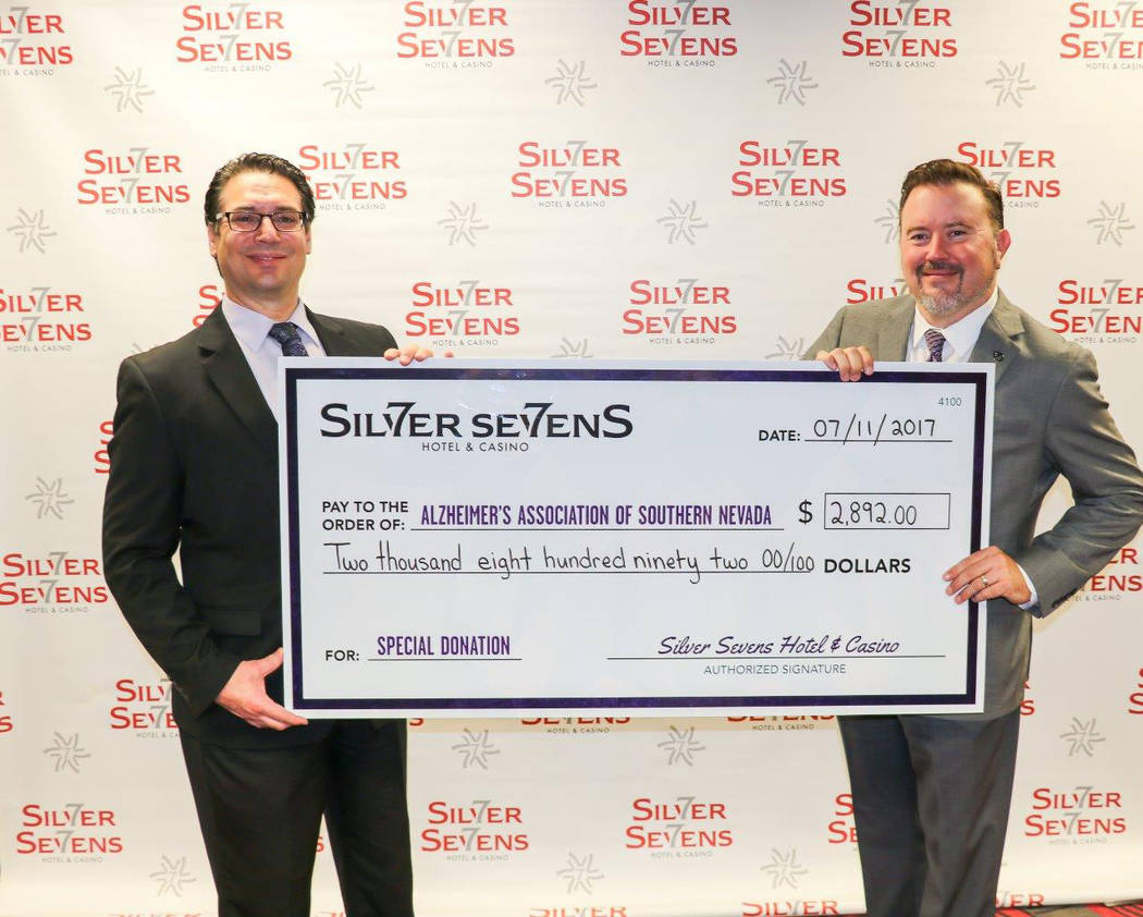 Silver Sevens General Manager Dan Uonites, left, presents Alzheimer's Association Desert Southwest Chapter Executive Director Dan Lawler with a check for $2,892 from Silver Sevens' month of pu ...