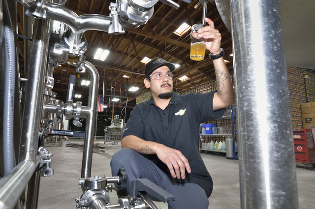 Assistant brewer Marcos Lopez checks a beer for clarity at Tenaya Creek Brewery at 831 W. Bonanza Road on Sept. 9, 2016. (Bill Hughes/Las Vegas Review-Journal)