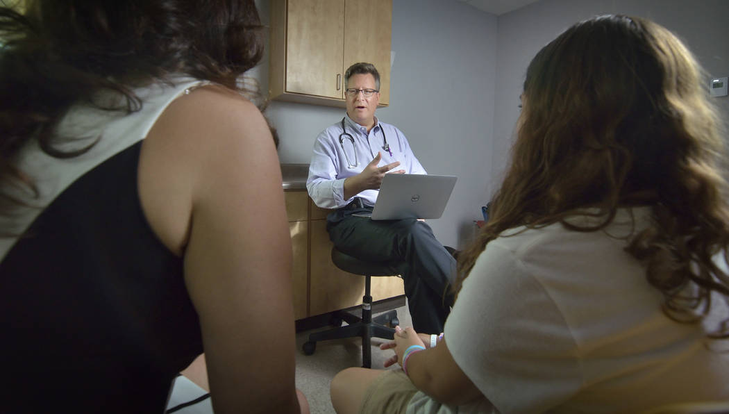 Dr. Howard Baron talks with Claudia Ferrer-Garcia, left, and her daughter, patient Sabrina Garcia. (Bill Hughes Business of Medicine)