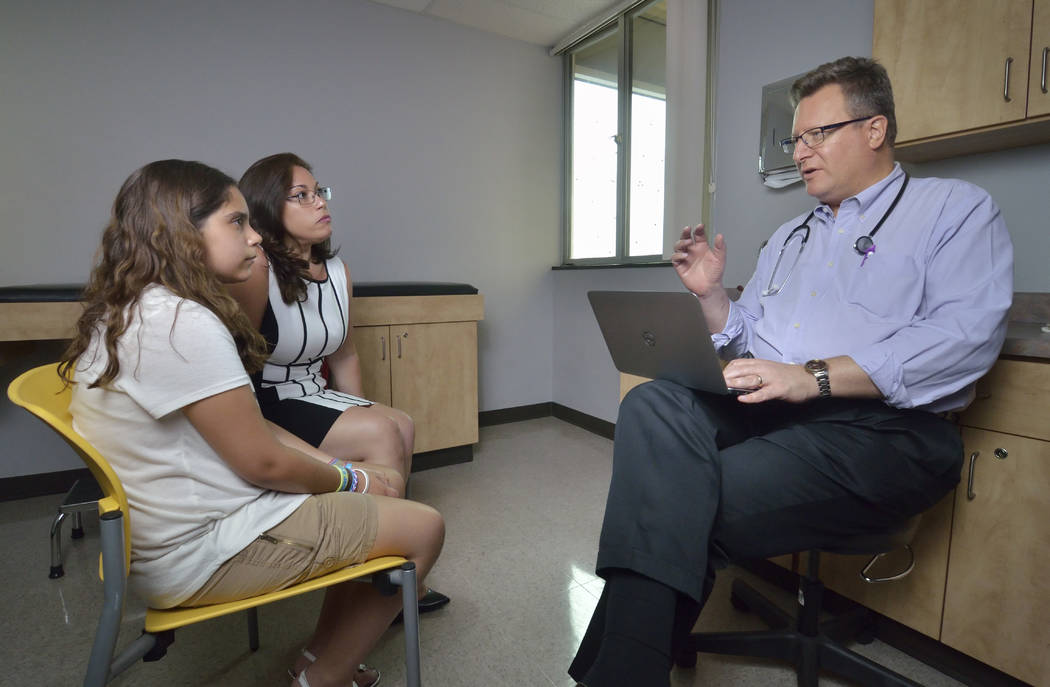 Dr. Howard Baron talks with patient Sabrina Garcia, left, and her mother Claudia Ferrer-Garcia at his practice at 3196 S Maryland Parkway. (Bill Hughes Business of Medicine)