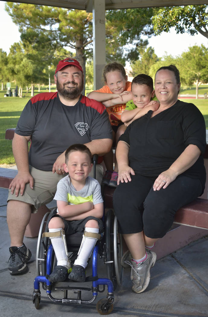 The McCabe family, from left, Francis II, Francis III, Emily, Landon and Melissa, are shown at the Aliante Nature Discovery Park at 2627 Nature Park Drive in North Las Vegas July 21. (Bill Hughes  ...