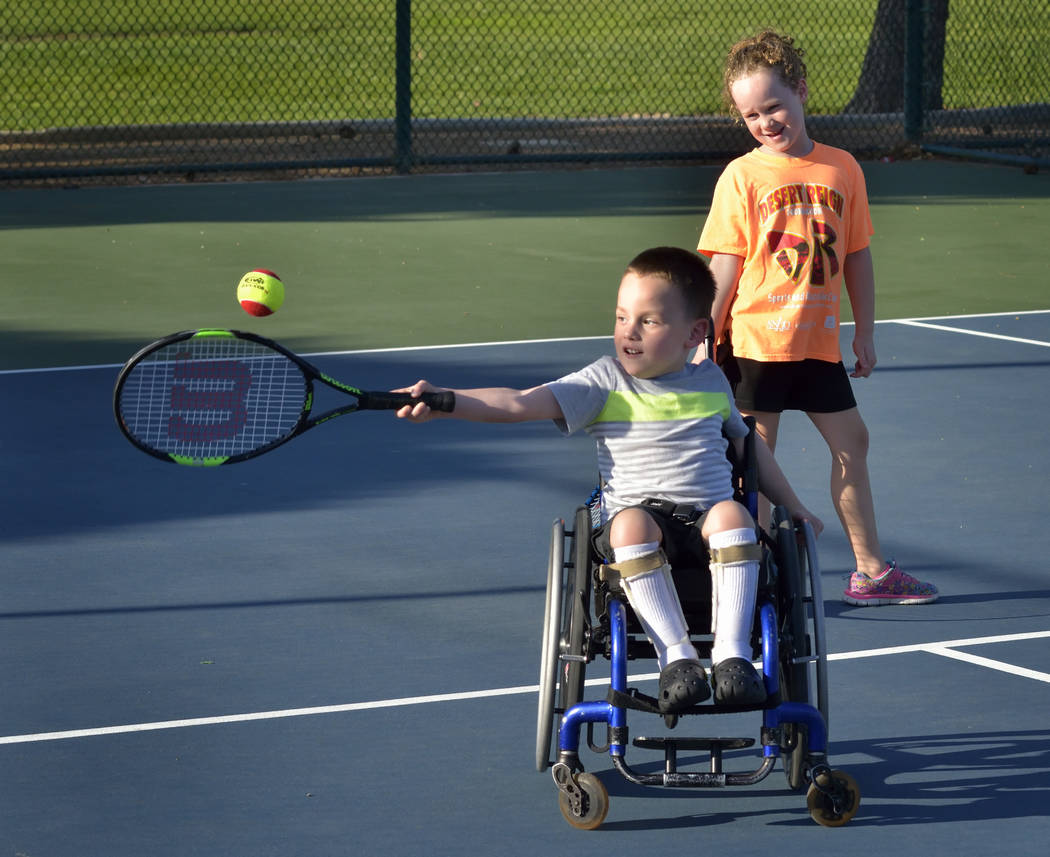 Francis McCabe III, left, and his sister Emily play tennis at the Aliante Nature Discovery Park at 2627 Nature Park Drive in North Las Vegas on July 21. (Bill Hughes Business of Medicine)