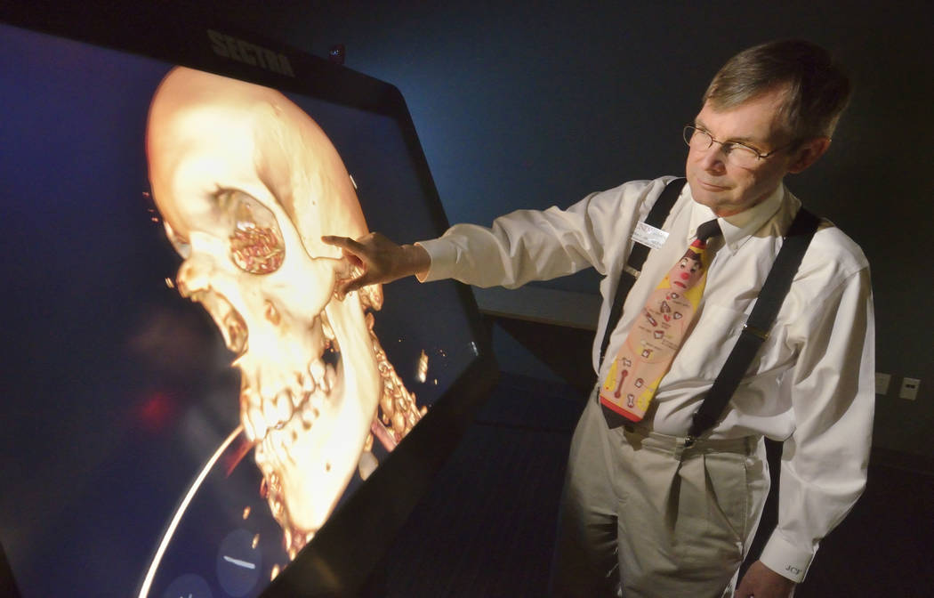 Dr. Jeffrey Fahl, professor of pediatrics and chair of the department of anatomy, demonstrates the Sectra virtual anatomy table at the UNLV School of Medicine on Shadow Lane April 20.  (Bill Hughe ...