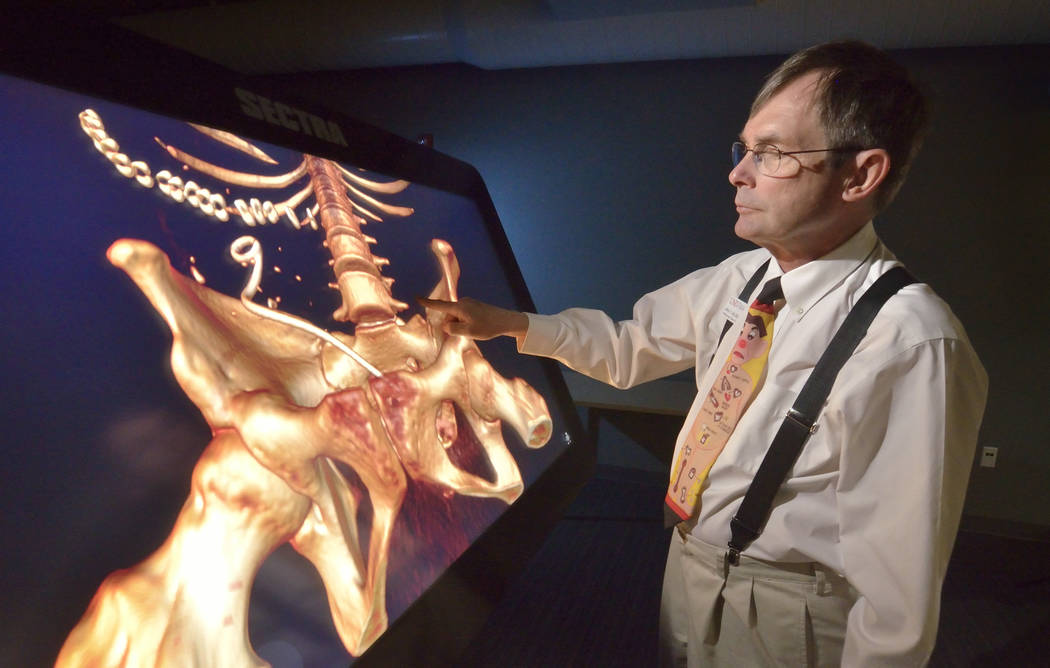 Dr. Jeffrey Fahl, professor of pediatrics and chair of the department of anatomy, demonstrates the Sectra virtual anatomy table at the UNLV School of Medicine on Shadow Lane. (Bill Hughes Business ...