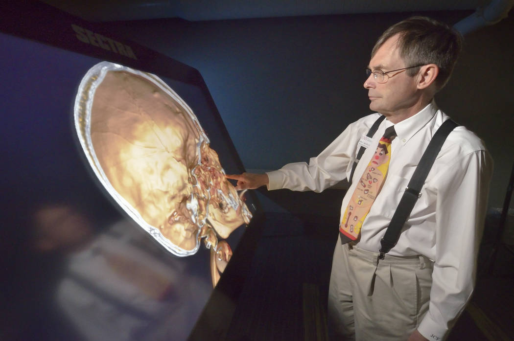 Dr. Jeffrey Fahl, professor of pediatrics and chair of the department of anatomy, demonstrates the Sectra virtual anatomy table at the UNLV School of Medicine on Shadow Lane April 20. (Bill Hughes ...