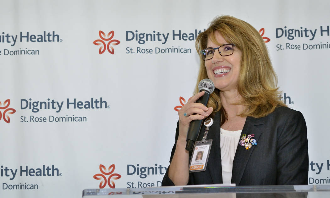 Laura Hennum, regional CEO for Dignity Health-St. Rose Dominican Neighborhood Hospitals, speaks during an open house and ribbon-cutting ceremony at the Dignity Health's neighborhood hospital at 48 ...