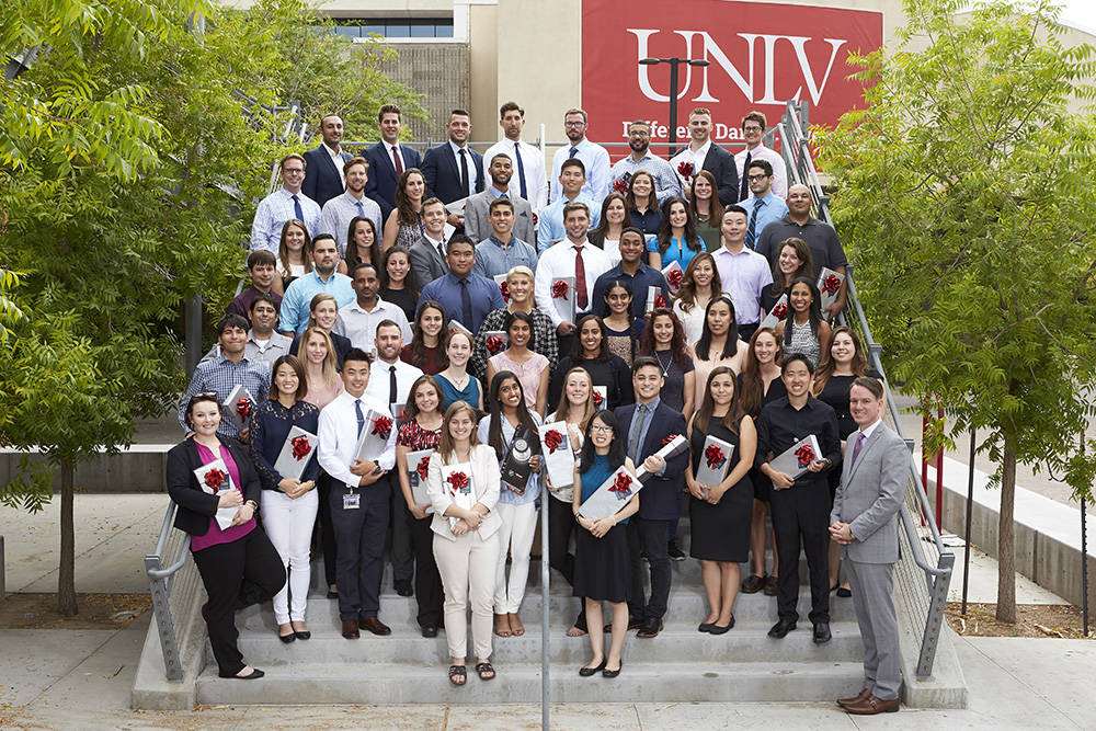 UNLV School of Medicine Class of 2021 pose for group portrait at the stethoscope celebration with stethoscope donor, Constantine George, lower right, July 17. (R. Marsh Starks / UNLV Creative Serv ...