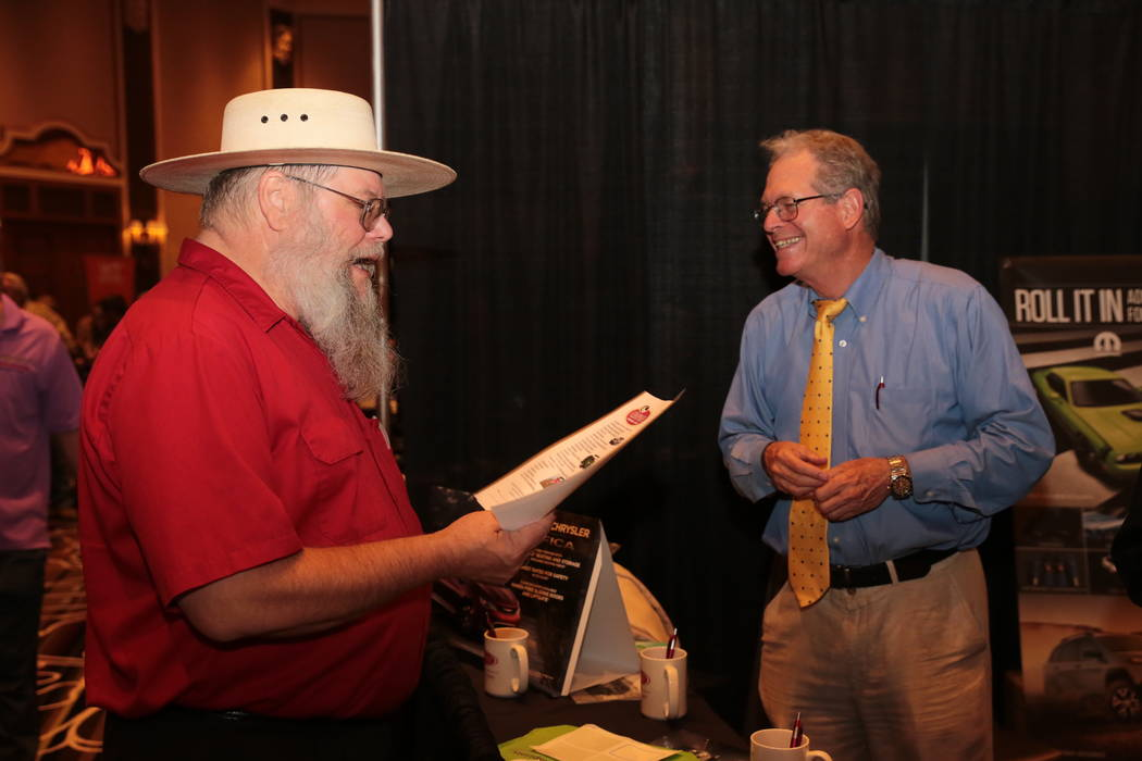 """Mark Hall Patton, museum administrator for the Clark County Museum system and frequent historian on the TV show """"Pawn Stars,"""" chats with Mike Strahan, fleet and vehicle sales with Chapman. (Ti ..."""