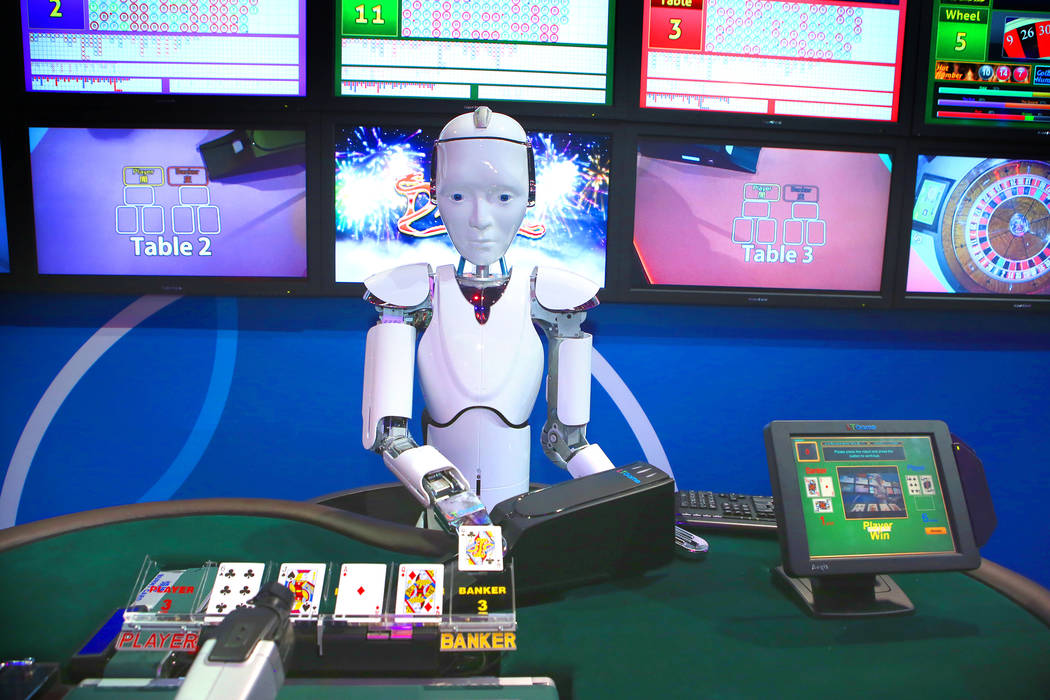 A robot deals baccarat in the IGT booth during the Global Gaming Expo at the Las Vegas Sands Expo and Convention Center on Sept. 29, 2016. G2E kicked off this morning as planned after a mass shoot ...