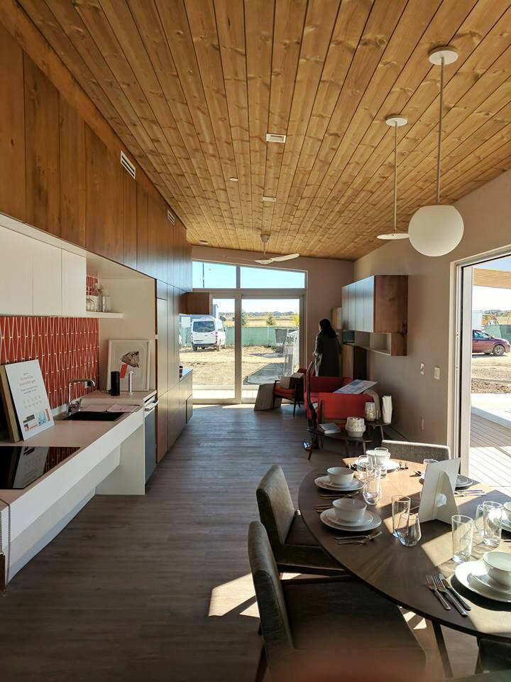 The UNLV team designed and built the dining room and living area into the front of the home with sliding glass doors that can extend the internal space outside to the patio area. (UNLV)