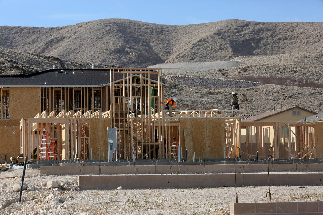 Construction workers put up new homes at Legends, a Lennar development in the Southern Highlands community on Nov. 3. (Michael Quine Las Vegas Business Press)