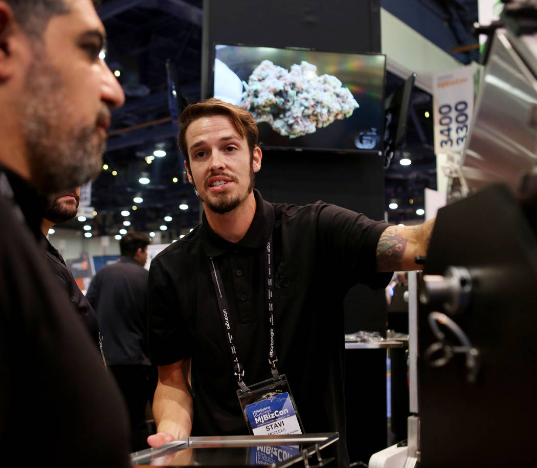 Stave McClees , regional sales manager for GreenBroz Inc., shows a model of their Trichome Extractor during the Marijuana Business Conference at the Las Vegas Convention Center in Las Vegas Nov. 1 ...