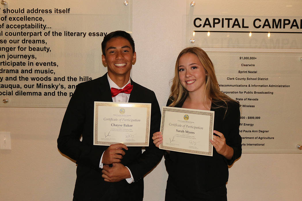 Chayse Baker and Sarah Myers receive certificates of participation for the MiniMed internship program sponsored by the Clark County Medical Society. (Clark County Medical Society)