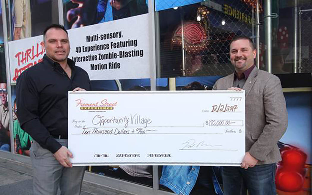 On Dec. 5, Fremont Street Experience, the five-block entertainment district in historic downtown Las Vegas, presented Opportunity Village with a check for $10,000 in honor of the 13th annual Las V ...