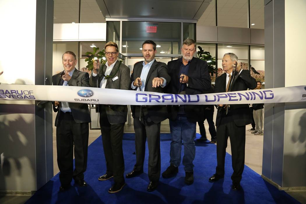 RIBBON CUTTING: The newly built Subaru of Las Vegas dealership recently presented its grand opening at 6455 Roy Horn Way at Rainbow Blvd. and the I-215. Shown cutting the ribbon are, from left, Fi ...