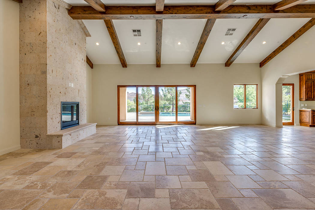 This home in Southern Highlands features a living room with a fireplace. (Shapiro & Sher Group)